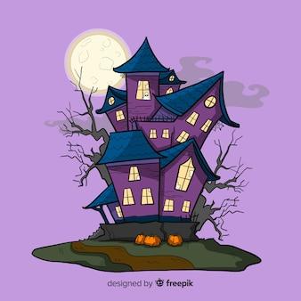 Casa encantada de halloween dibujada a mano