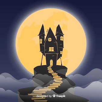 Casa encantada de halloween con diseño plano