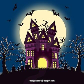 Casa de halloween con murciélagos y cementerio