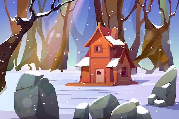 Casa de madera en bosque de invierno.