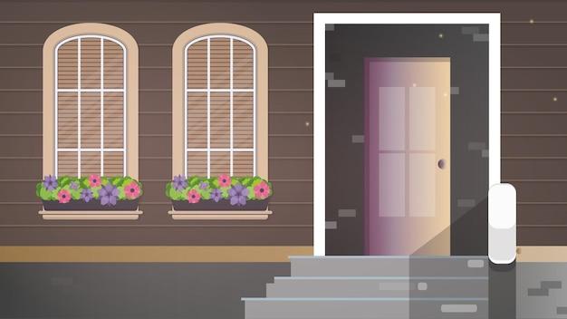 Casa de madera marrón con grandes ventanales. ventanas con flores. porche de una casa de campo.