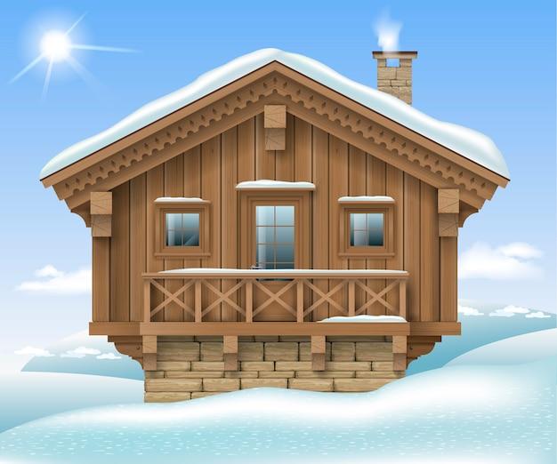 Casa de madera en las montañas de invierno.