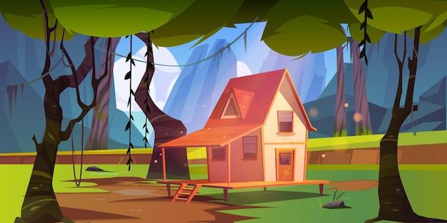 Casa de madera en selva con montañas.