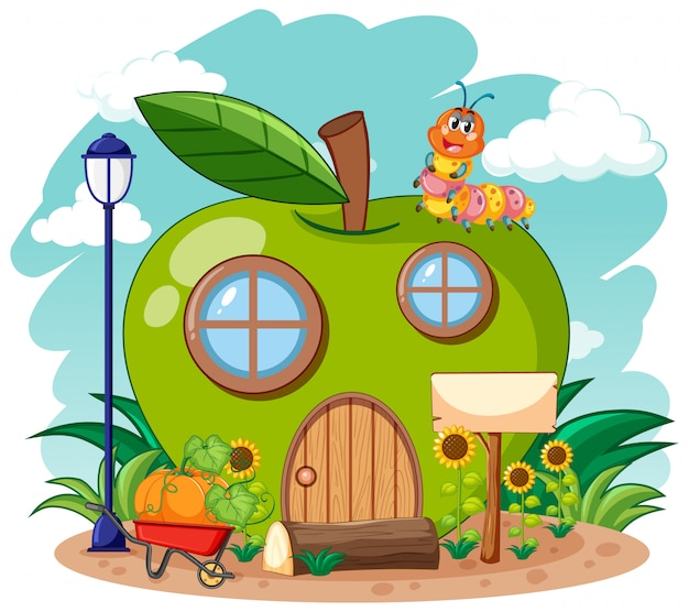 Casa de manzana verde y lindo gusano en el jardín estilo de dibujos animados sobre fondo de cielo