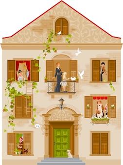 Casa de piedra retro con gente en ventanas