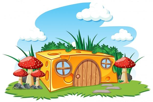 Casa de queso con champiñones y en el jardín estilo de dibujos animados sobre fondo de cielo