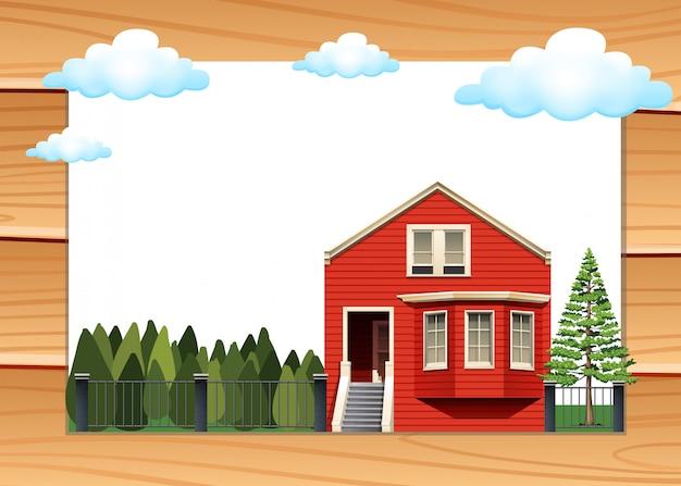 Casa roja en el marco de la pared de madera