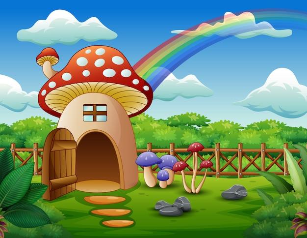 Casa de setas con un arcoiris en el campo.