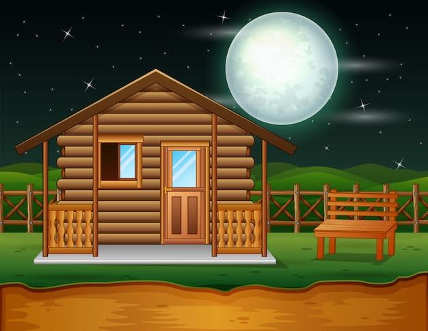 Una casa tradicional de madera en la escena nocturna.