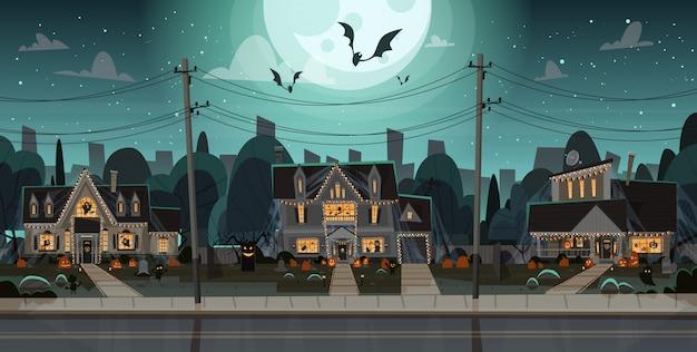 Casas decoradas para halloween, vista frontal con diferentes calabazas