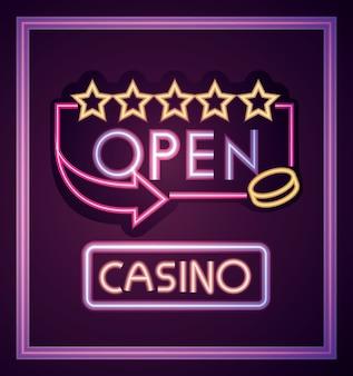 Casino, letrero de neón de estrellas de tablero abierto en pared de ladrillo