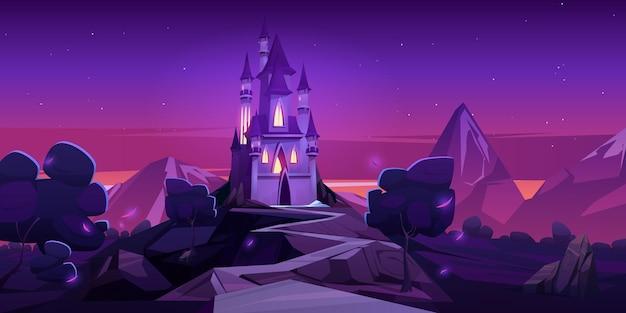 Castillo de cuento de hadas en las montañas por la noche