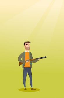 Cazador caucásico joven que sostiene un rifle de caza