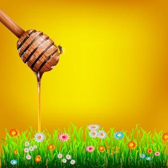 Cazo de miel con abejas y hierba verde con flores.