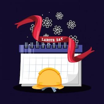 Celebración del día del trabajo con casco de seguridad y calendario.