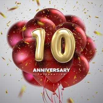 Celebración del primer aniversario. número 10 dorado con confeti brillante y globos rojos voladores.