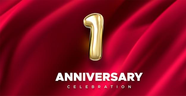 Celebración del primer aniversario. número de oro 1 sobre fondo textil drapeado rojo.