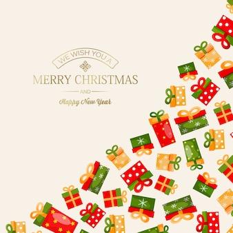 Celebrando la tarjeta de feliz navidad y año nuevo con inscripción de saludo dorado y coloridas cajas de regalo en luz
