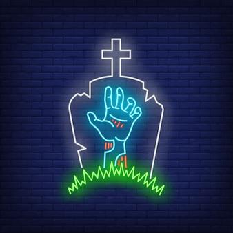 Cementerio con signo de neón de mano de lápida y zombie