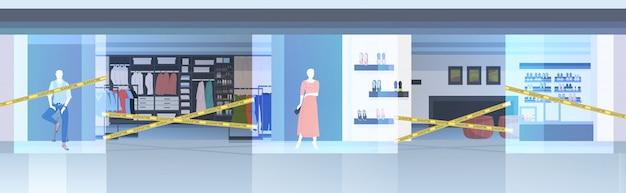 Centro comercial vacío con cinta amarilla coronavirus pandemia cuarentena concepto covid-19