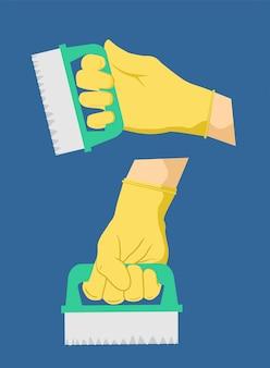 Cepillo de limpieza del hogar en la mano. equipos de desinfeccion, saneamiento