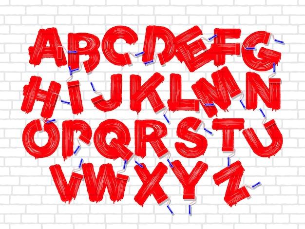 Cepillo de rodillo de color rojo alfabeto de graffiti en el fondo de pared blanca de ladrillo antiguo