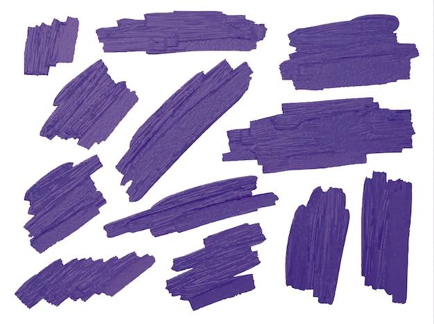 El cepillo violeta alimenta la textura en el fondo blanco