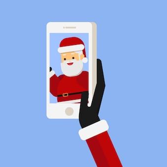 Cerca de la mano de santa tomando selfie de santa