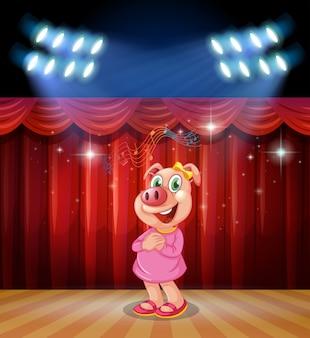 Cerdo realizar en el escenario