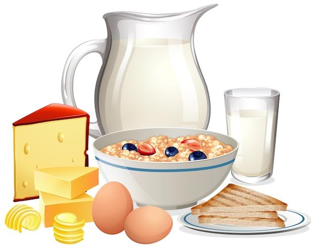 Cereales para el desayuno en un tazón con jarra de leche en un grupo aislado sobre fondo blanco.