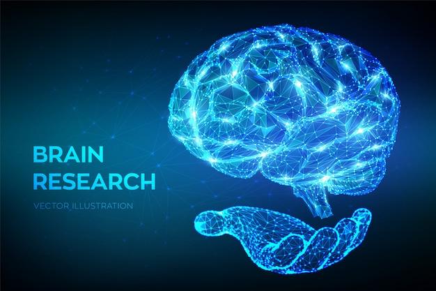 Cerebro. bajo poligonal abstracto cerebro humano digital en la mano.