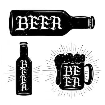 Cerveza y letras en botella de cerveza y taza.
