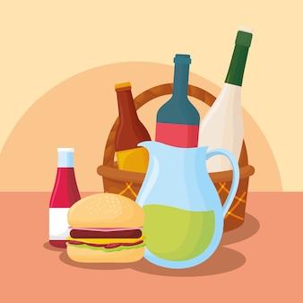 Cesta con botellas de vino y comida de picnic