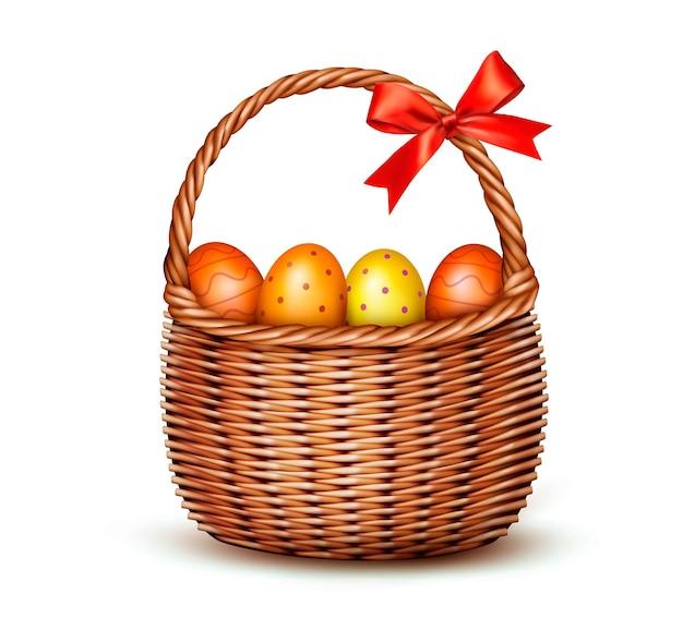 Cesta con huevos de pascua y lazo rojo.