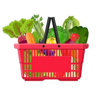 Cesta llena con diferentes alimentos saludables.