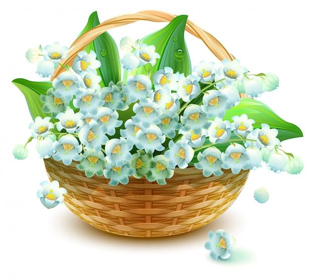 Cesta de mimbre de flores. flor de lirio del valle. ramo lirio de los valles