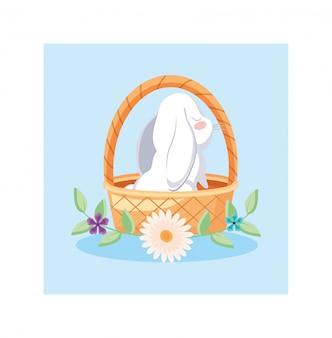 Cesta de mimbre con lindo conejo