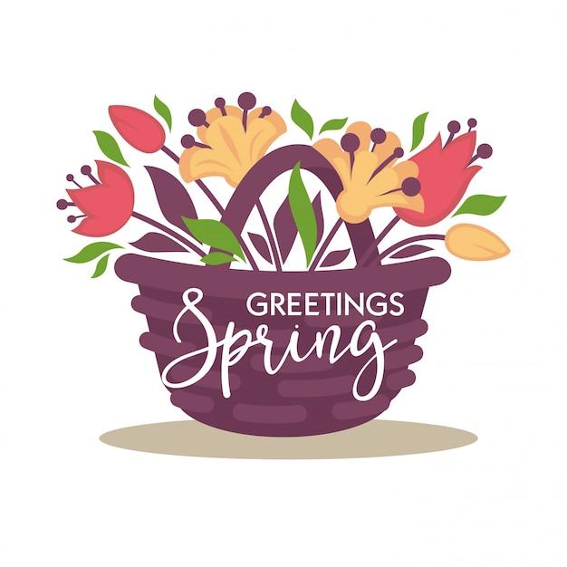Cesta de mimbre de saludos de primavera con ramo de flores.