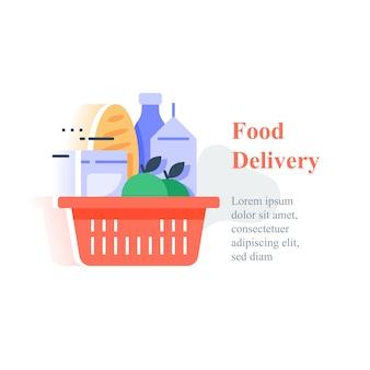 Cesta roja llena de comestibles, abundancia de productos de supermercado, compra de alimentos y entrega a domicilio