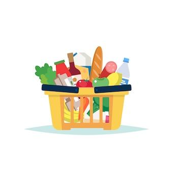 Cesta de supermercado llena de comestibles diferentes