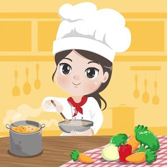 Chef chica está cocinando y sonríe en la cocina