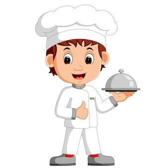 Chef divertido de dibujos animados con un plato de plata