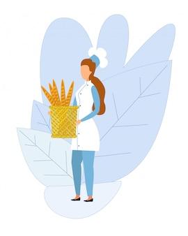Chef mujer sosteniendo la cesta con pan recién horneado