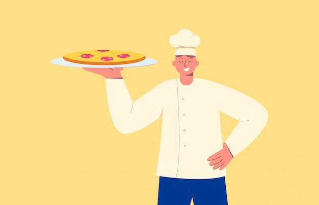 Chef con plato. sonriendo cocinero con pizza de pepperoni preparado, uniforme blanco.