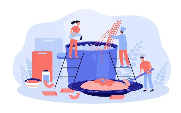 Chef del restaurante y su equipo cocinando pasta
