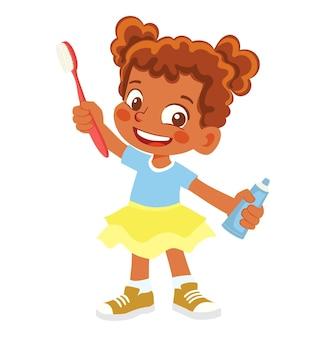 Chica afroamericana sosteniendo un cepillo de dientes y pasta de dientes