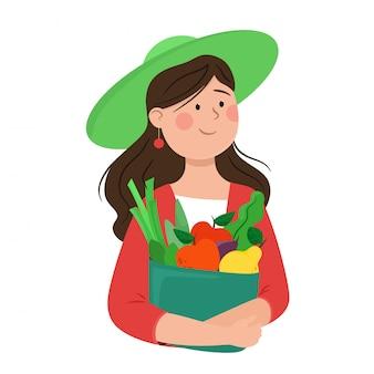 Chica agrónoma sostiene un paquete con ensaladas y frutas. ilustración en estilo plano de dibujos animados.