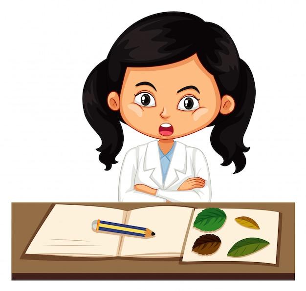 Chica en bata de ciencias aprendiendo sobre plantas