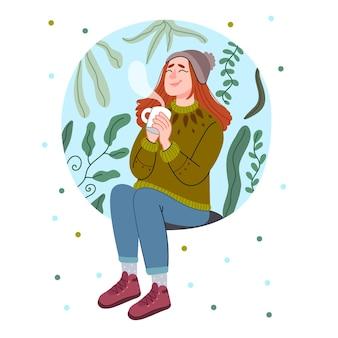Chica bebe té mujer joven en un acogedor suéter sentado bebiendo té caliente.