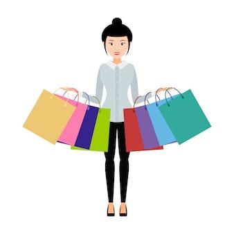 Chica con bolsas de compras en ambas manos. .